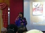 Julie Sudiro singing at KL book launch